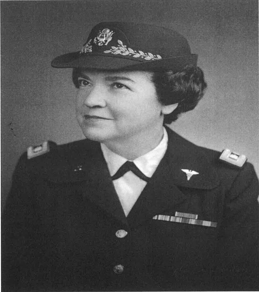 Black and white headshot of Ruby Linn. She is wearing a military uniform, smiling.