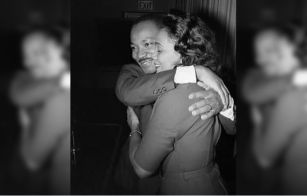 A black and white photo of Dr. MLK Jr. and Coretta Scott King hugging, MLK on the left and Coretta on the right.