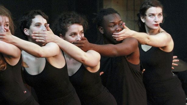 Performer Simona Minns with four dancers