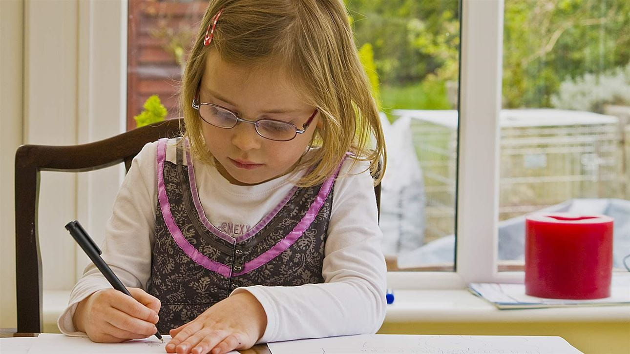 4-year-old concentrating on work with pencil