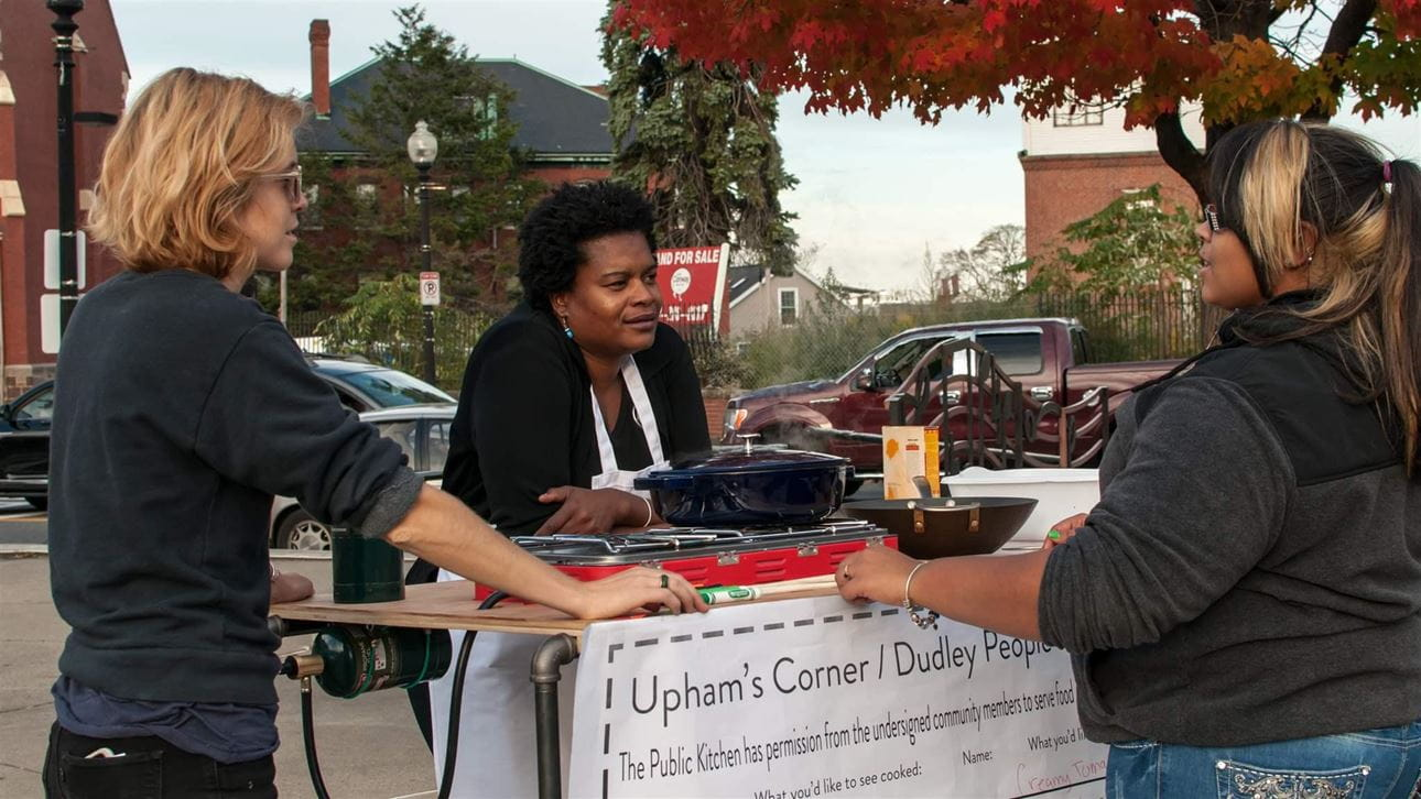 three women at Upham's Corner booth