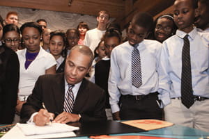 Governor Patrick signing ed reform legislation photo