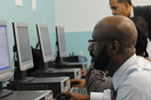 Man at computer job training